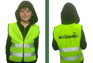 kid in peacemaker vest