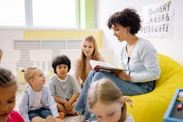 teacher reading book in classroom